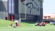 The Denver Broncos practice field at the UC Health Training Center undergoes maintenance for training camp including painting the fields maintaining...
