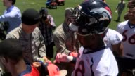 The Denver Broncos took time after practice to sign autographs for military members who were invited to the team's practice facility for the day...