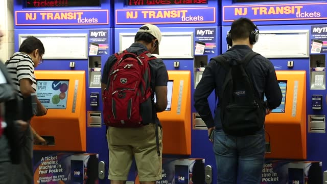 The departure board for Amtrak and New Jersey Transit trains is seen at Pennsylvania Station in New York United States on Tuesday July 10 Commuters...