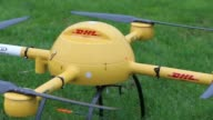The DHL logo sits on a parcel delivery drone manufactured by Microdrones GmbH ahead of flight testing by Deutsche Post AG's parcel delivery unit on...