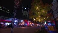 The DistrictLive Music Venues sign partial tree w/ ATT building BG