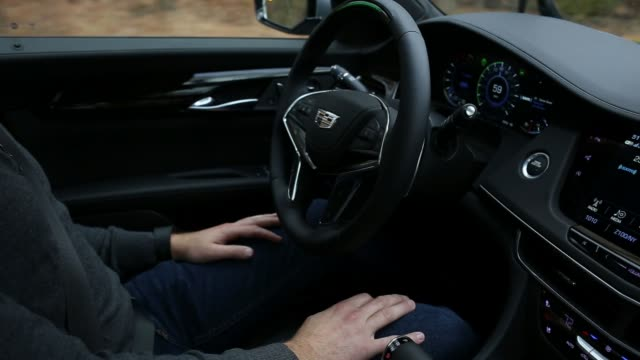 The driver crosses his arms as the Cadillac CT6 operates in it's Super Cruise SemiAutonomous feature on the road in NY on November 16 2017...