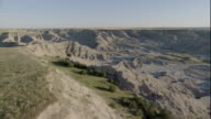 The dry and rugged South Dakota Badlands stretch across a vast prairie. Available in HD.