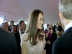 The Duchess of Cambridge chats to Saffron Aldridge and various guests at the ARK 10th anniversary gala dinner