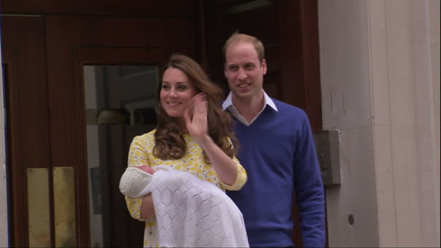 The Duchess of Cambridge gives birth to a baby girl Shows exterior shots Prince William Catherine walking out to crowds carrying the Princess in...