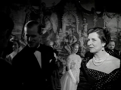 The Duchess of Kent and Prince Philip chat to various people at the film premiere of Les Belles de Nuit 1953