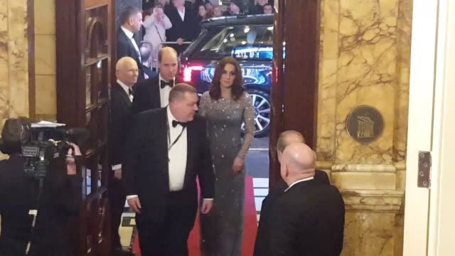 The Duke and Duchess of Cambridge have attended the Royal Variety Performance after their arrival was delayed by an incident which saw armed police...