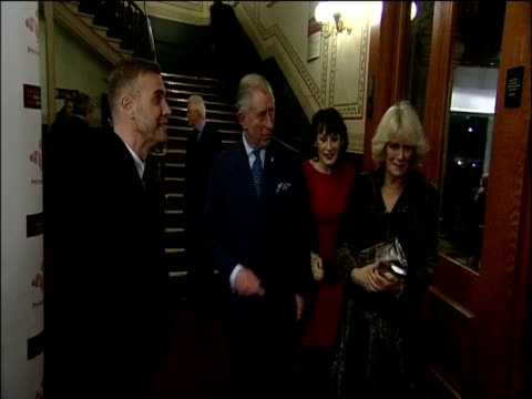 The Duke and Duchess of Cornwall and the Duke and Duchess of Cambridge arrive at a charity concert and are met by Gary Barlow London 7 Dec 2011