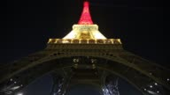 The Eiffel tower is lit up with the Belgian flag colours of black yellow and red on March 22 2016 in Paris France The tower has been litup in...
