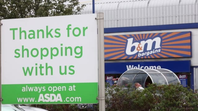 The entrance to a BM European Value Retail SA store stands beyond an ASDA Group Ltd supermarket sign in London UK on Monday July 24 2017
