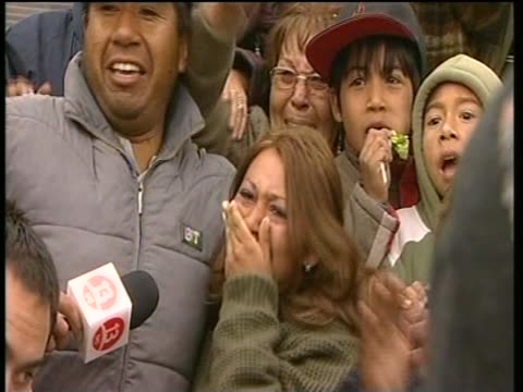 The family of Mario Gomez the oldest miner trapped 700 metres underground watch as he is rescued from the SanJose mine