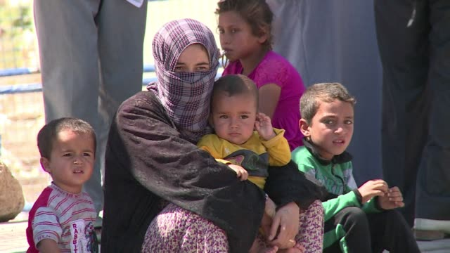 The first Syrian refugees return to the border town of Tal Abyad from Turkey after it was liberated from the Islamic State group