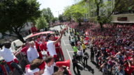 The firstteam squad are take part in an opentop bus tour of Islington following their dramatic FA Cup final victory against Hull City