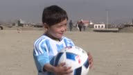 The five year old Afghan boy who became an Internet sensation when he was pictured wearing a plastic bag with Messi scrawled on it in marker pen...