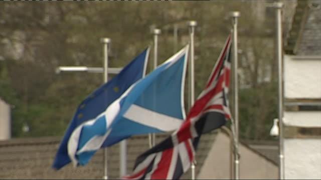 The flags of Great Britain Scotland and the European Union waving in the wind