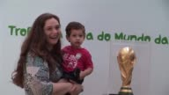 The football World Cup trophy is paraded and presented in Rio to as FIFA puts it stimulate the enthusiasm of Brazilian fans VOICED World Cup fever...
