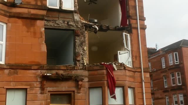 The front of a block of flats has been brought down in high winds as Storm Ophelia sweeps across Scotland The block in the south side of Glasgow...