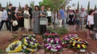 The funeral for three Israeli family members who died in a stabbing attack is held in Modiin
