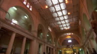 The gallery of a museum houses Ancient Egyptian artifacts.