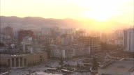 The golden hour sun shines over the skyline of central Tirana, Albania. Available in HD.