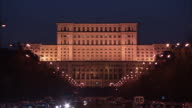 The grand Palace of Parliament is illuminated by floodlights in the city of Bucharest. Available in HD