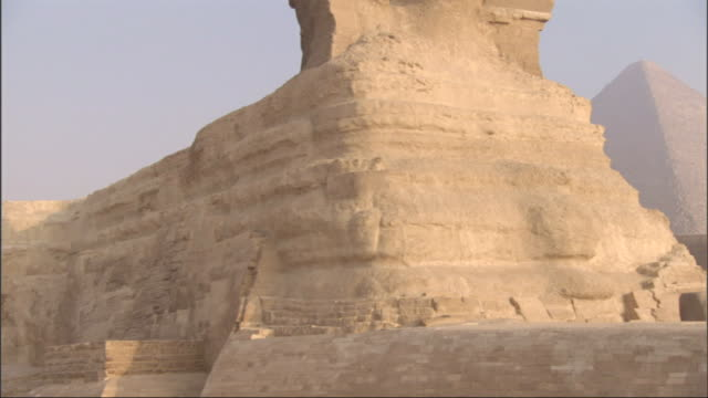 The Great Sphinx sits in front of the Great Pyramids.