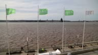 The Green Party logo sits on a flag as it flies beside the River Mersey during the partys spring conference in Liverpool UK on Friday March 6...