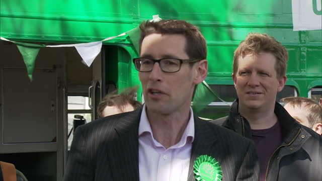 The Green Party reveal their battle bus in Bristol Shows exterior shots Darren Hall making speech to supporters about climate change and Green Party...