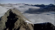 The high peaks of the Austrian Alps surround a massive glacier. Available in HD.