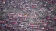 The hills around revered Tibetan Buddhist academy Larung Gar were once a seamless carpet of vibrant red dominated by the homes of thousands of monks...
