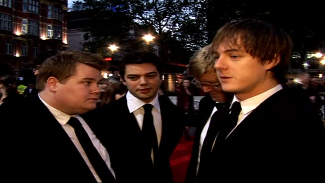 'The History Boys' Royal film premiere Close up of James Corden talking to press PULL OUT to back view of Dominic Cooper Alan Bennett and Andrew...