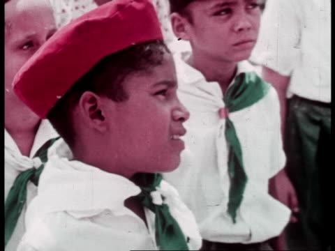 The history of the communist revolution being taught to children and the graves of the slain revolutionaires