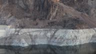 The Hoover Dam stands in Boulder City Nevada U S concrete arch gravity dam in the Black Canyon of the Colorado River that impounds Lake Mead the...