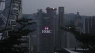 The HSBC Holdings Plc headquarters building center and Standard Chartered Bank building right stand in Hong Kong China on Saturday July 29 2017 The...