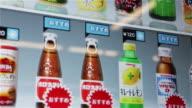 CU The huge touchscreen display of an ultra-modern vending machine / Tokyo, Japan