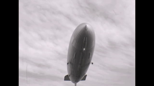 The illfated Hindenburg Zeppelin Airship as viewed from the deck of the Queen Mary whilst at sea The montage consists of an approach shot a...