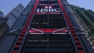 The illuminated logo for HSBC Holdings Plc is displayed atop the bank's headquarters building at night in Hong Kong China on Sunday July 30 2017...
