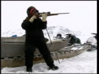 The impact of global warming on the Inuit community CANADA Nunavut Baffin Island EXT Music overlaid over following sequence Inuit hunter along on...
