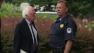 The independent US senator for Vermont walks on grounds of the Capitol building and hugs a Capitol Hill police officer who gives him directions away...