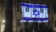 The Israeli flag is projected on the front of the Hotel de Ville in Paris on Tuesday evening in tribute to the victims of the Jerusalem attack...