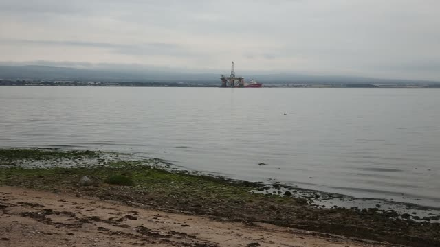 The J W McLean oil drill rig operated by Transocean Ltd stands anchored in the Cromarty Firth as the offshore pipelay vessel Deep Energy operated by...