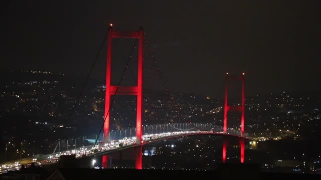 The July 15 Martyrs' Bridge's lights are turned off to mark the Earth Hour 2017 environmental campaign in Istanbul Turkey on March 25 2017 The lights...
