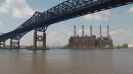 The Kearny Power Generating Station under the Pulaski Skyway on a beautiful spring day.  The Hackensack river flows underneath.