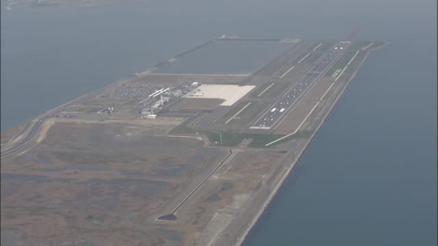 The Kitakyushu Airport juts out onto the Pacific Ocean in Kitakyushu City, Japan.