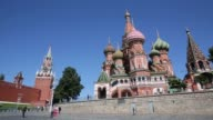 The Kremlin building left and St Basil's cathedral right stand on the banks of the Moscow river in Moscow Russia on Monday June 8 2015 Shots...