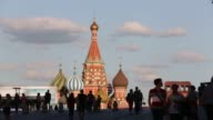 The Kremlin buildings sit on Red Square seen through an archway at the GUM department store in Moscow Russia on Monday June 8 2015 Shots the GUM...