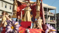 The Krewe of Thoth Queen float passes Lee Circle on St Charles Avenue in New Orleans during Mardi Gras