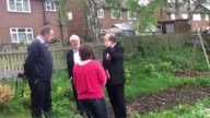 The Labour leader is shown around an allotment t a community centre in Pudsey Leeds