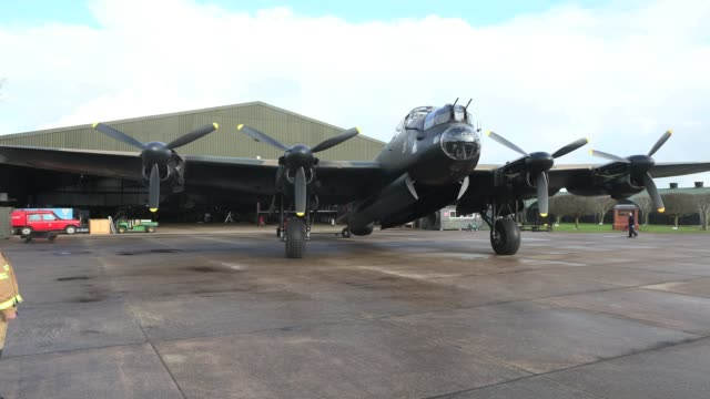 The Lancaster bomber 'Just Jane' gets off its hangar before an engine test with the aim of getting it airworthy at Lincolnshire Aviation Heritage...