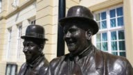 The Larel and Hardy statue outside the Coronation hall in Ulverston, Cumbria, UK. Stan Laurel was born in Ulverston. The statue was designed and constructed by the artist Graham Ibbeson.